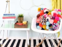 DIY crazy pom pom pillow 200x150 Unleash Cuteness: 15 Fuzzy DIY Projects Made With Pom Poms