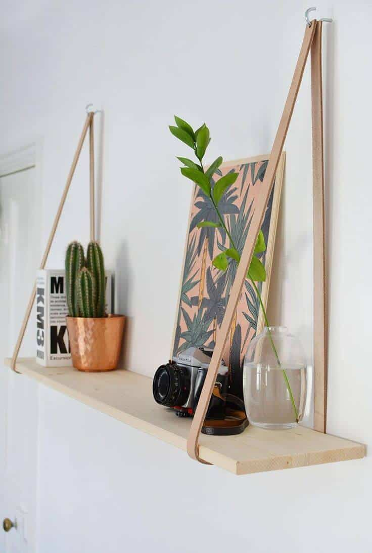 Hanging leather strap shelf