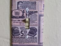 Vintage newspaper outlet 200x150 15 Interesting DIY Ways to Customize Light Switch and Outlet Covers