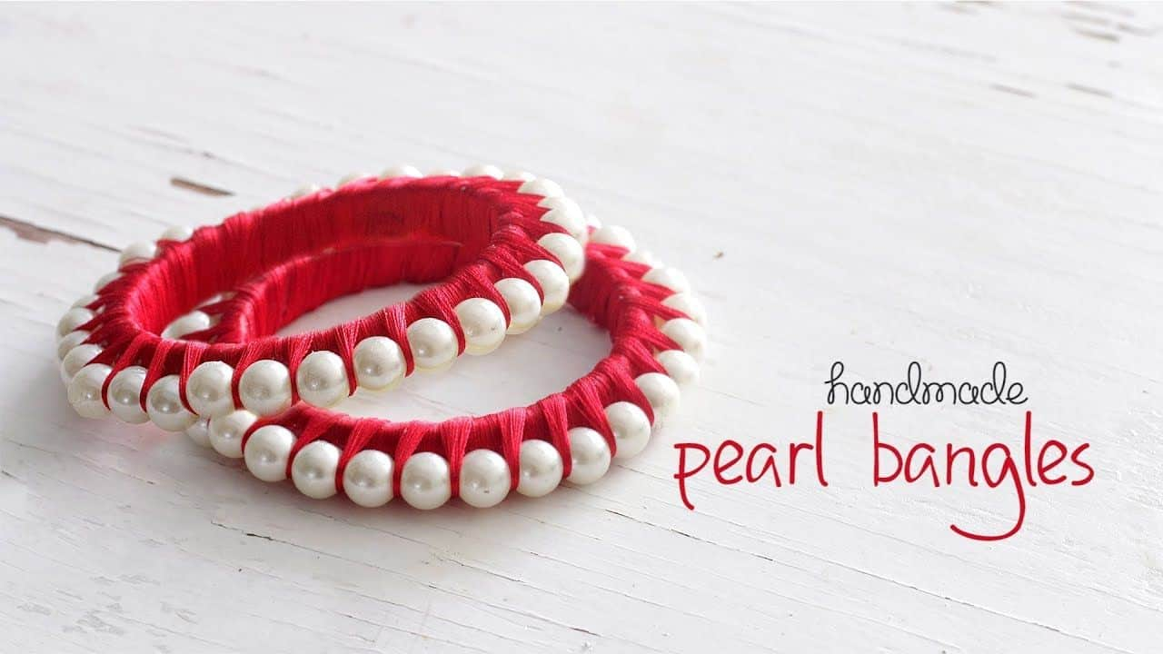 Embroidery wrapped pearl bangles