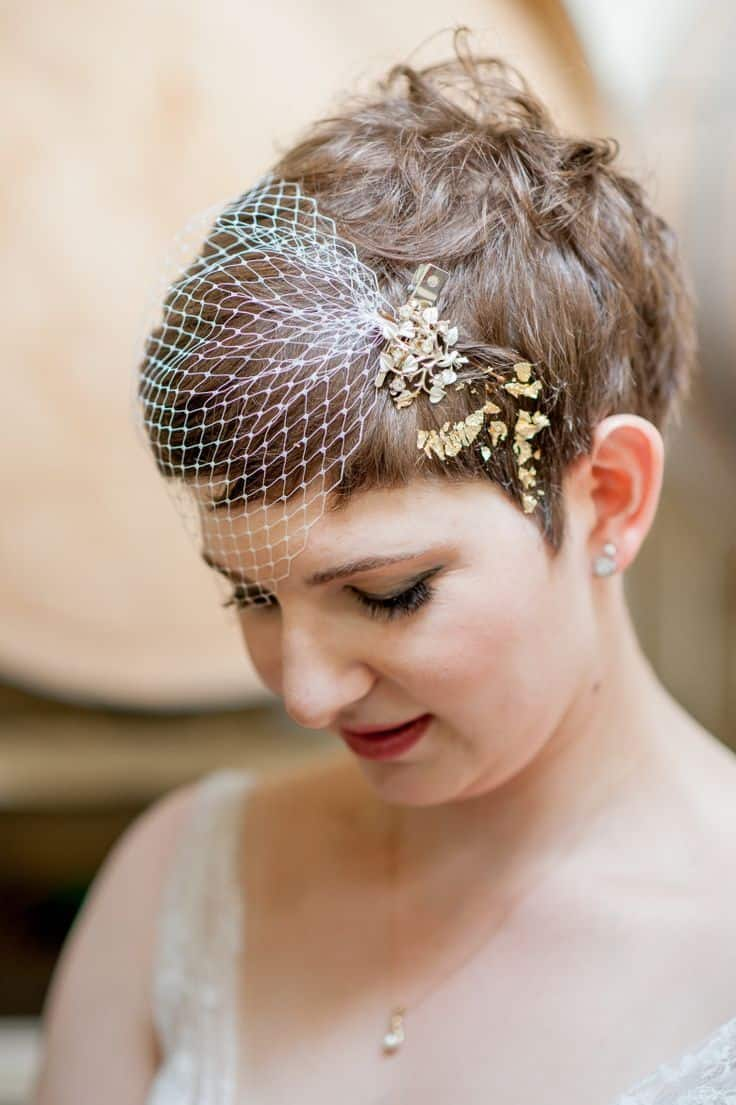 Gold leaf and netting fascinator