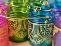 Hand painted mason jar lanterns 200x150 14 Great Ways to Transform and Repurpose Mason Jars