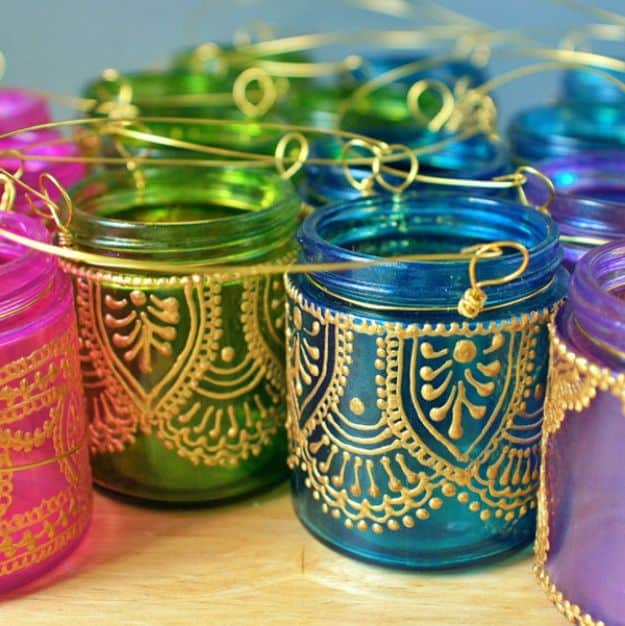 14 great ways to transform and repurpose mason jars hand painted mason jar lanterns view in gallery have your very best diy solutioingenieria Image collections