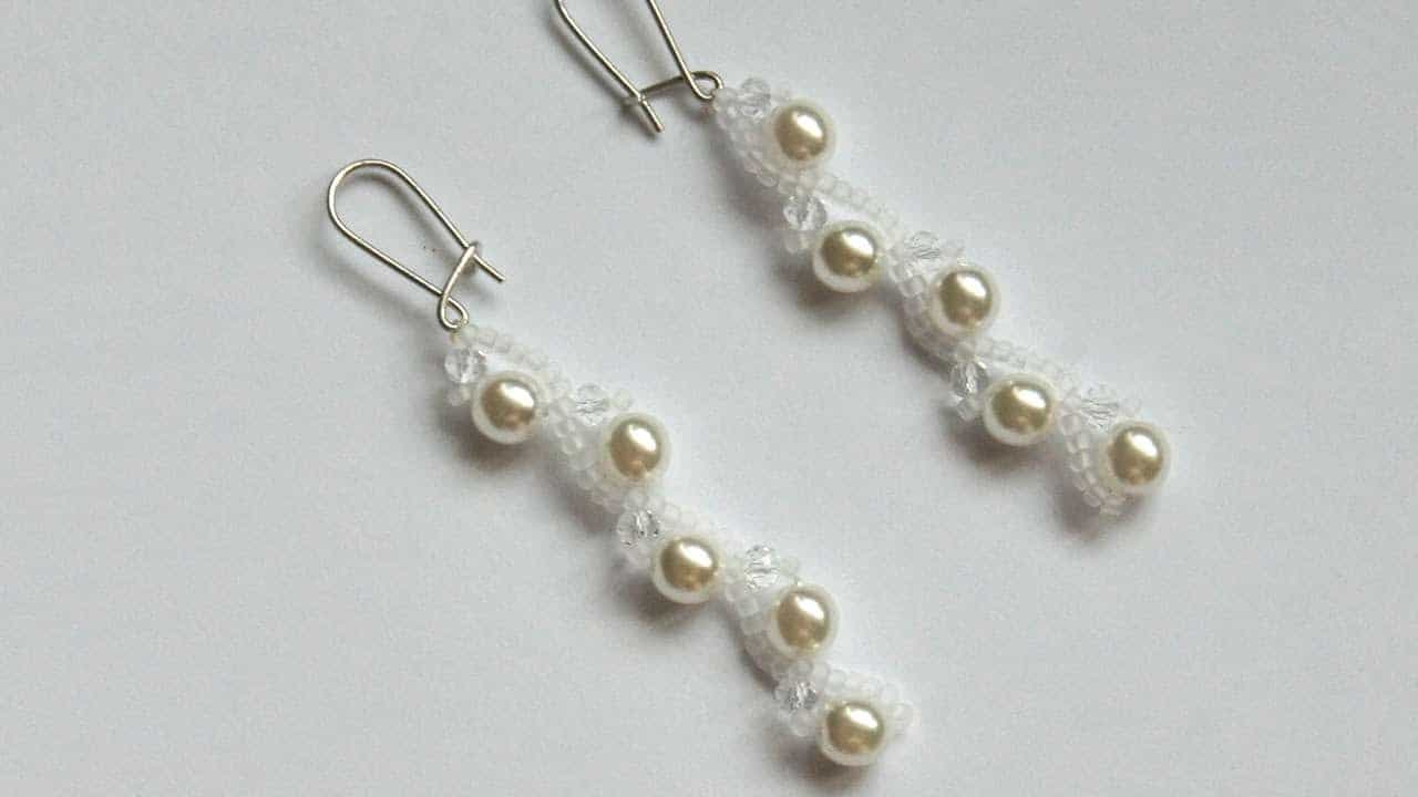Hanging woven pearl earrings