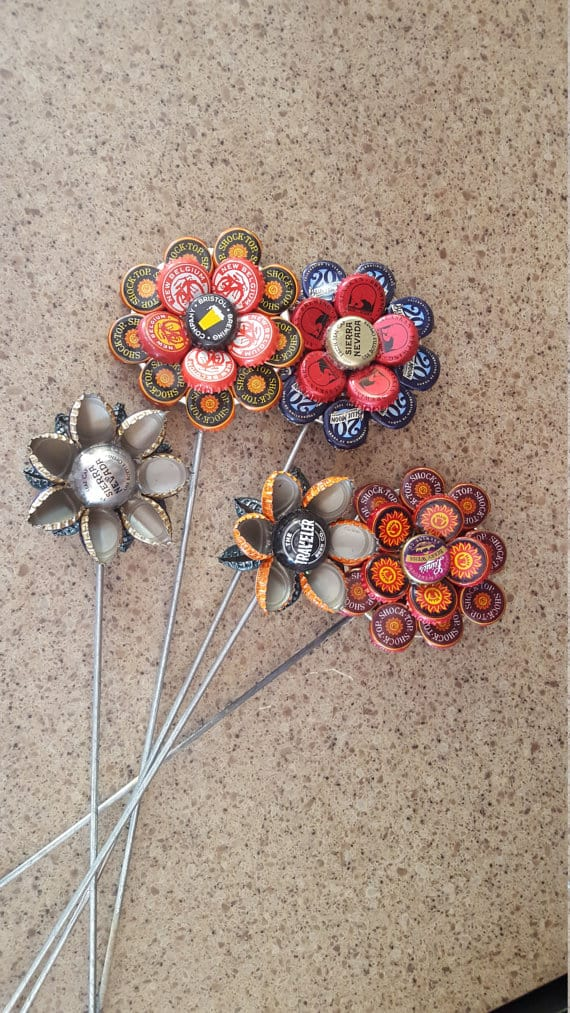 Layered and bent bottle cap flowers