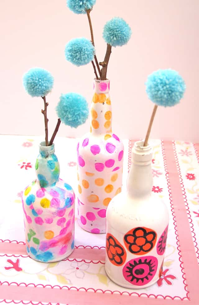Tissue decoupaged wine bottle vases
