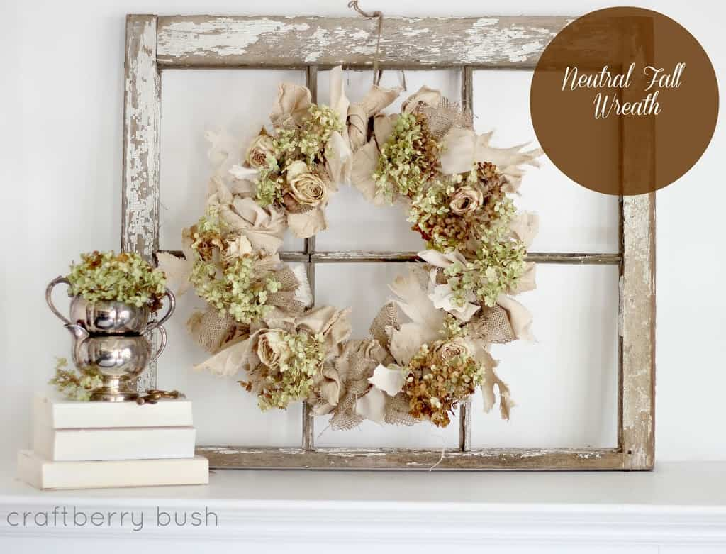 Burlap and dried flower wreath on a rustic upcycled window