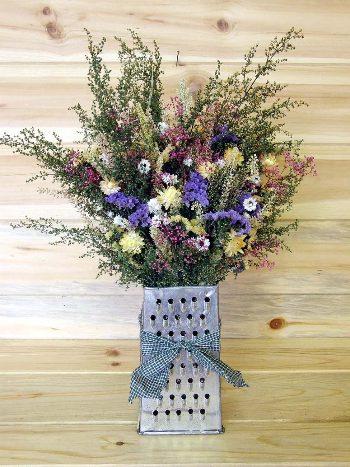Dried country flower bouquet in a grater