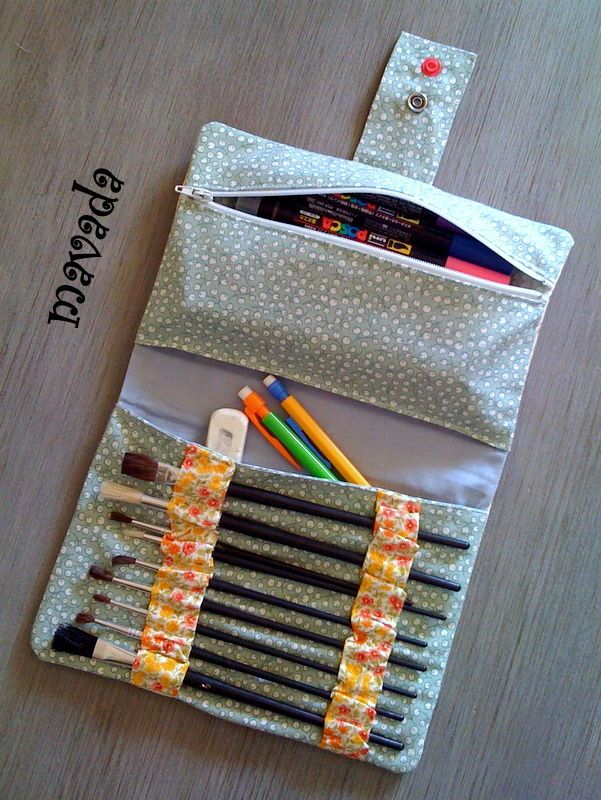 Folding pencil case with slides and a zippered pouch