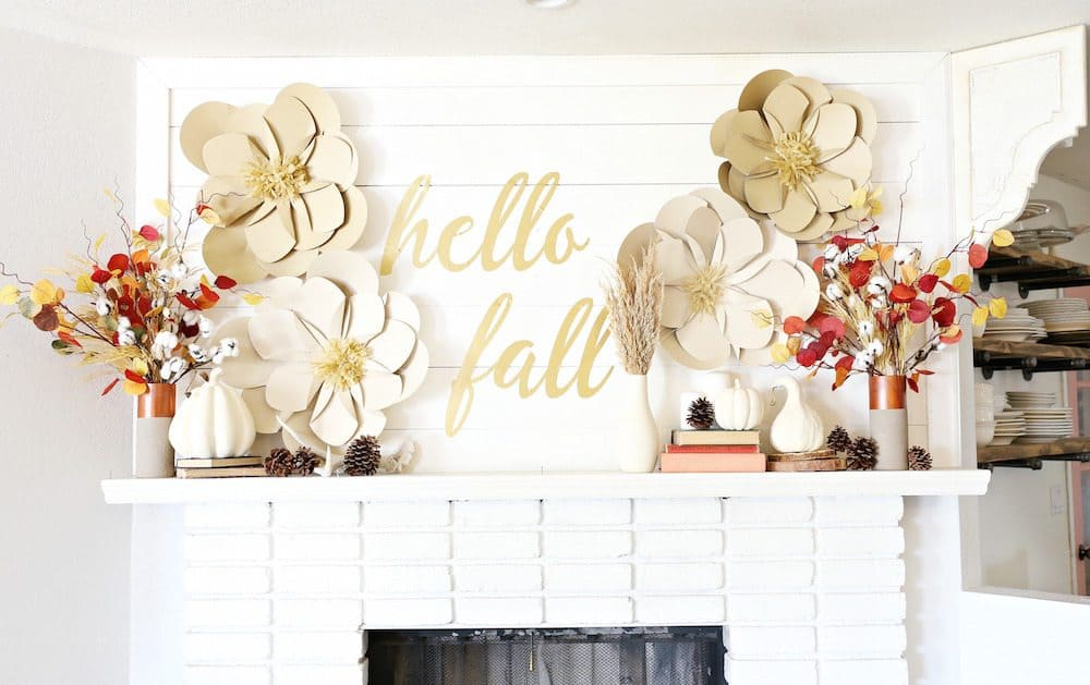 Quote board and paper flowers mantel
