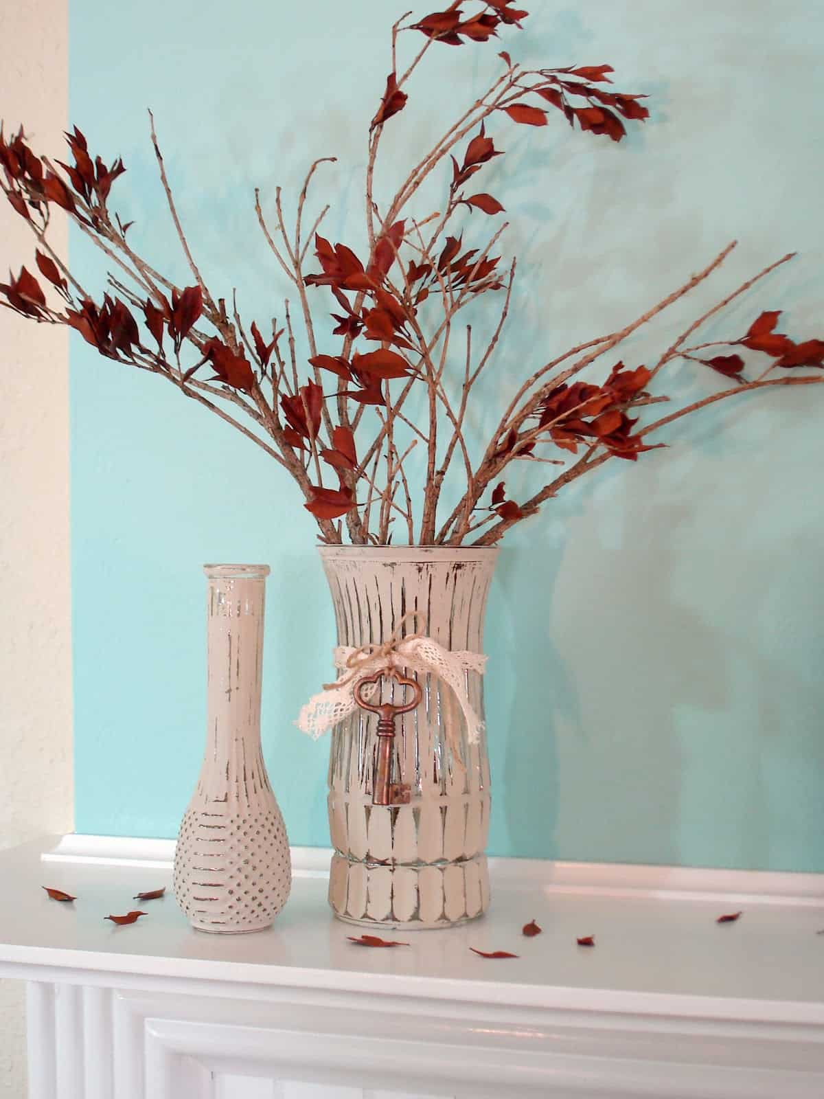 Weathered paint and dried leaf vase