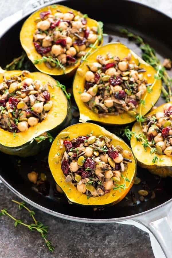 Acorn squash stuffed with wild rice, cranberry, mushroom, and chickpeas