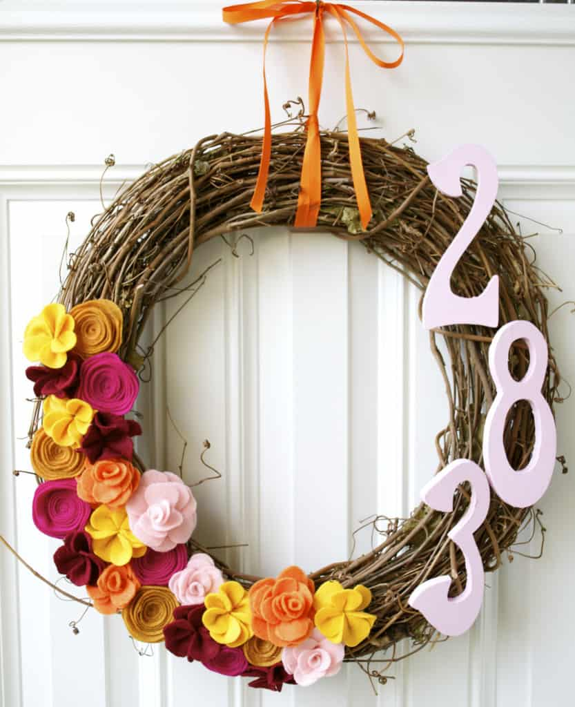 Branches, felt flowers, and street number wreath