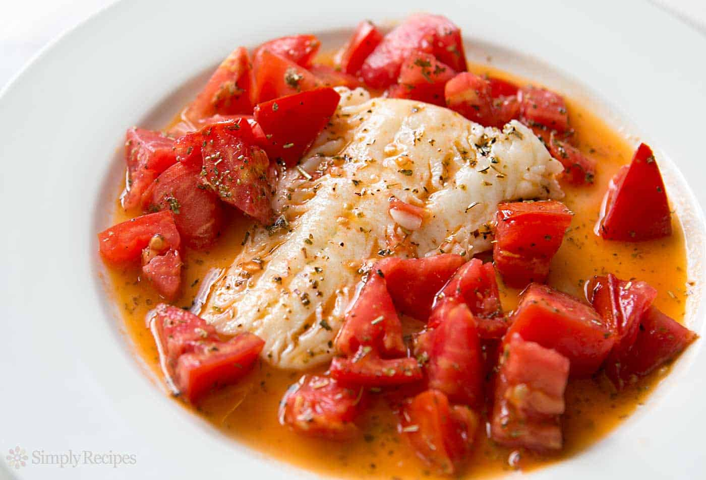 Cod sauteed in olive oil with fresh tomatoes