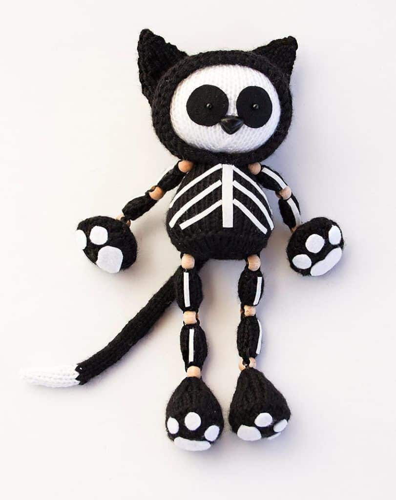 Knitted skeleton cat doll