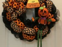 Mesh and ribbon Jack O Lantern wreath 200x150 A Spooky Invitation: Best DIY Halloween Door Wreaths