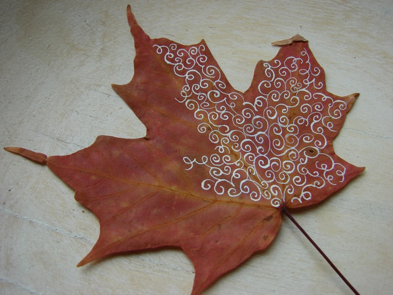 Metallic hand drawn leaf