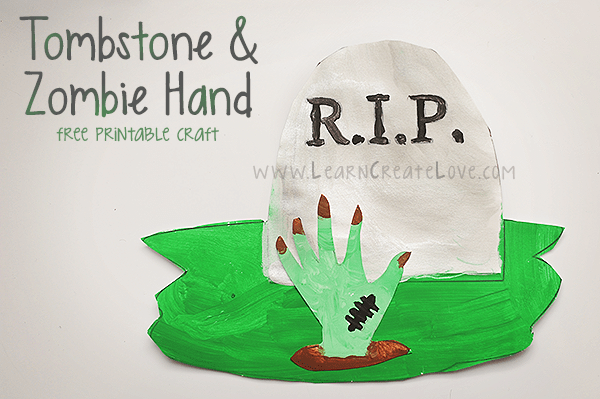Paint and paper gravestone and zombie hand