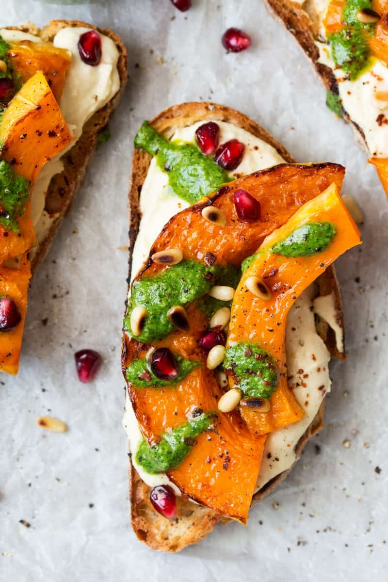 Pumpkin crostini with arugula and pesto
