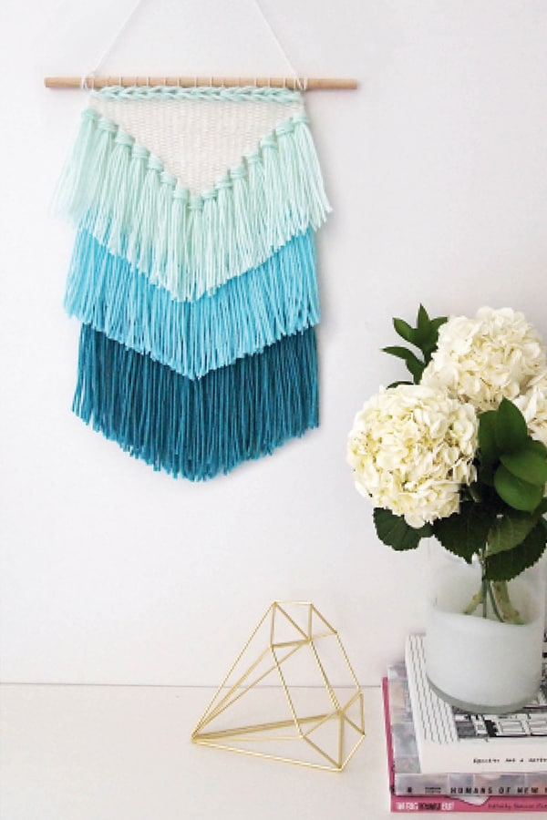 Adding tassels to woven pieces