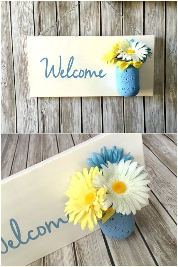 Board and mason jar flowers sign