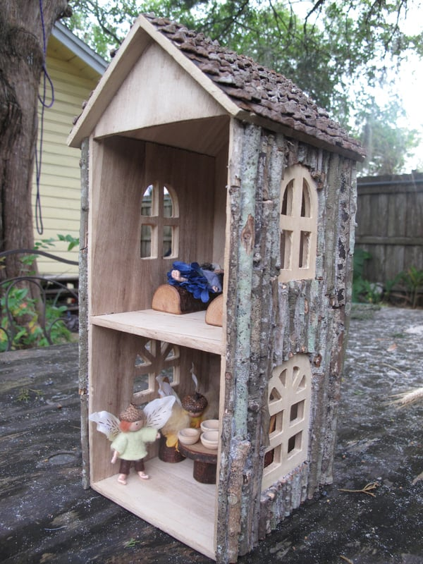 Branch and bark covered dollhouse