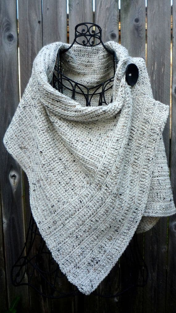 Cream tweed wrap with a large button