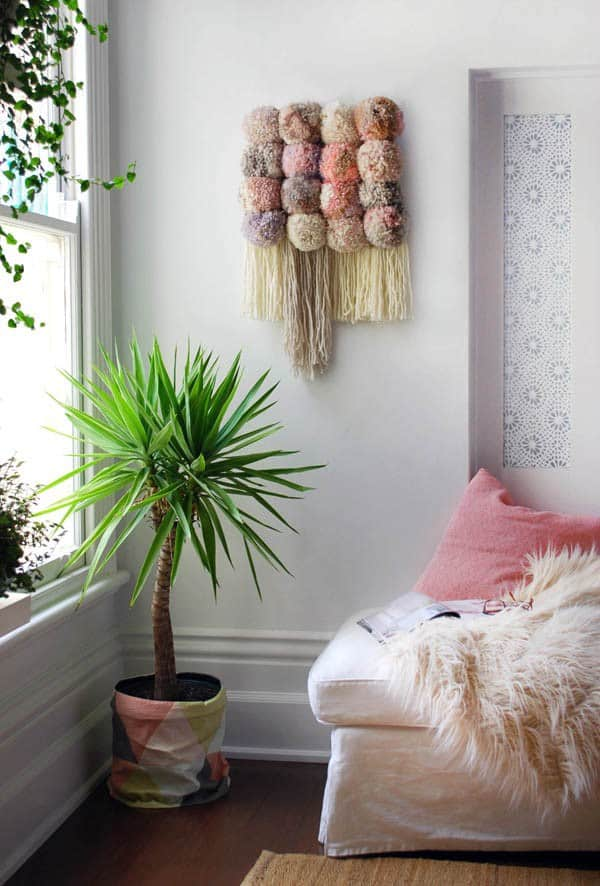Jumbo pom pom and fringe wall weaving