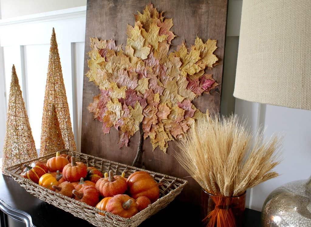 Layered decoupage leaf art on wood