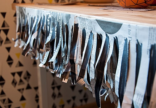 Newspaper table skirt party decor