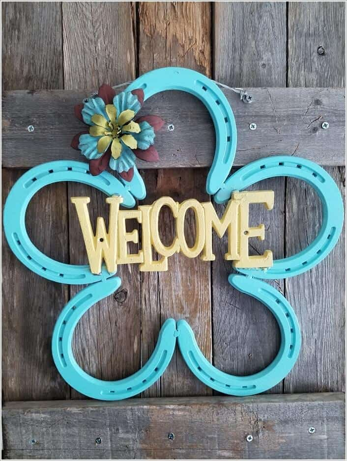 Painted horseshoe welcome sign