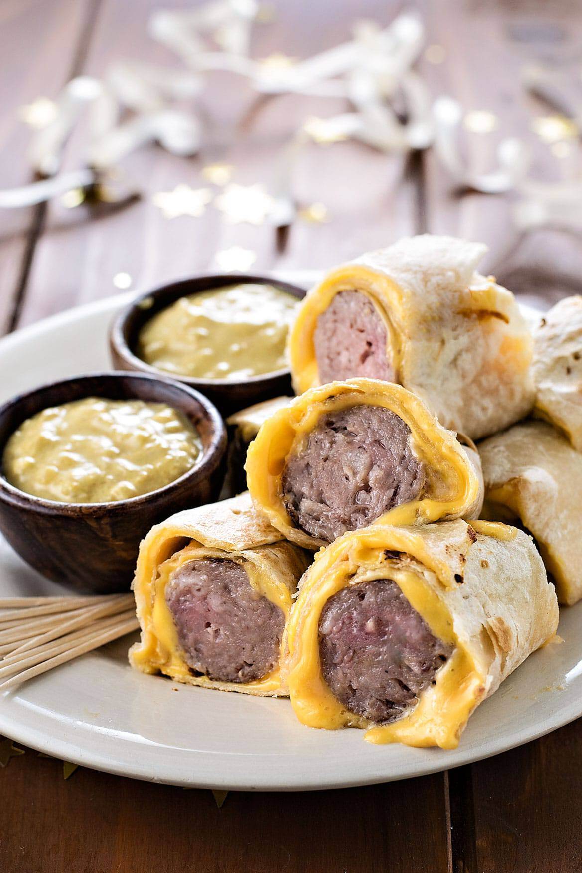 Torilla wrapped bratwursts with beer mustard