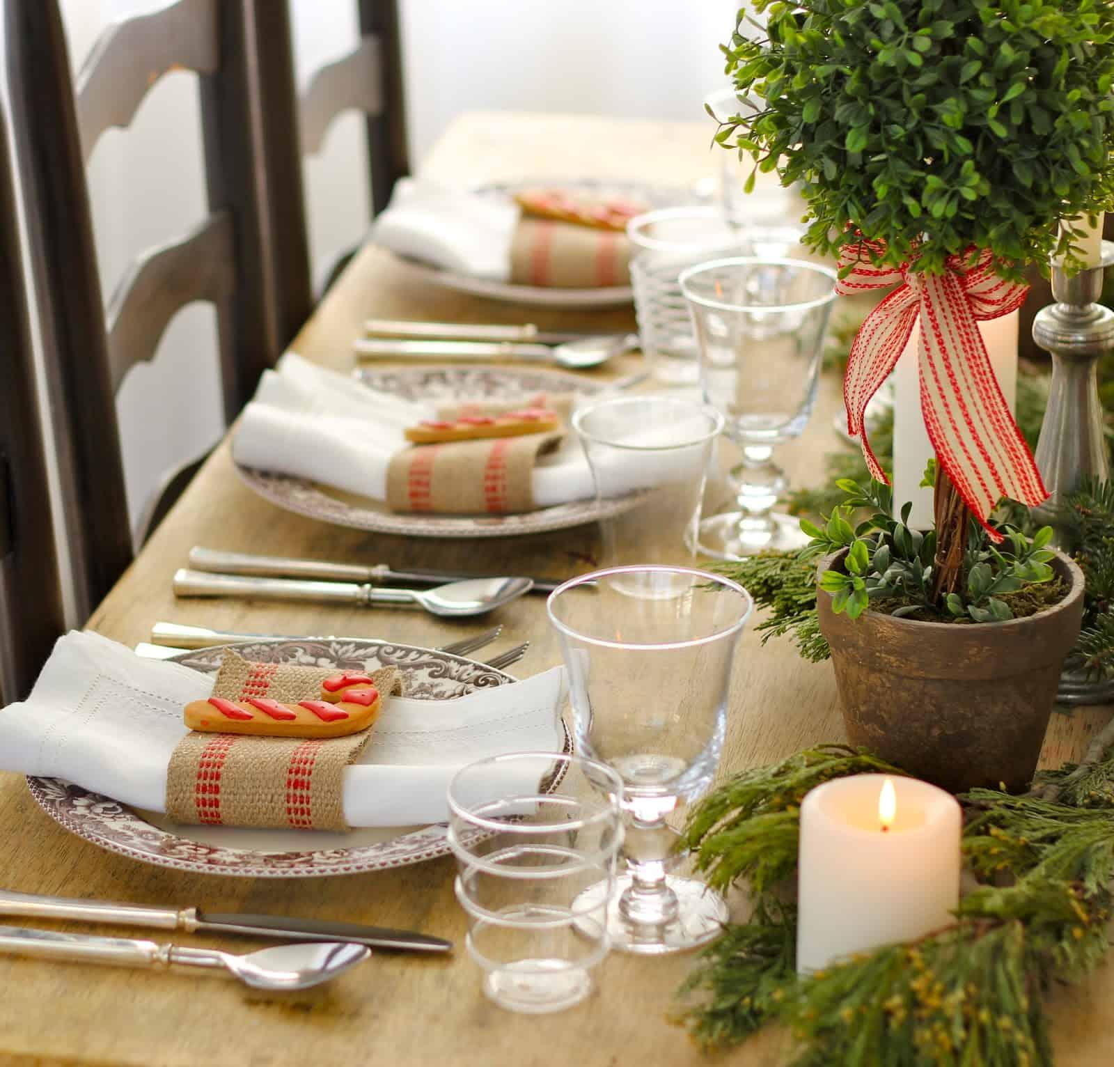 Miniature holiday trees and burlap napkin wraps