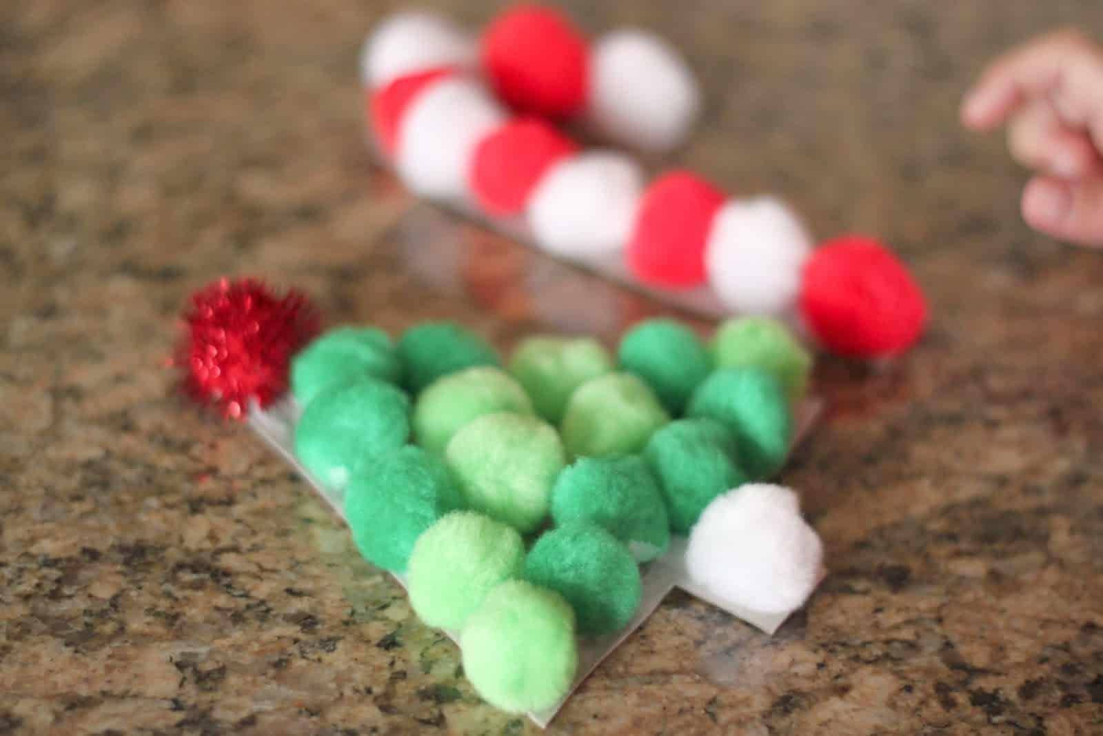 Pom pom Christmas tree and candy cane stick craft