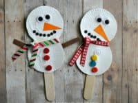Snowman paper plate and stick puppets 200x150 White Christmas Joy: 15 Cute Snowman Themed Crafts for Kids