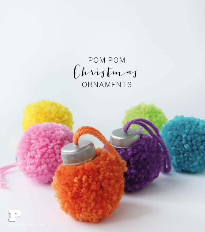 Yarn pom pom and bottle cap ornament