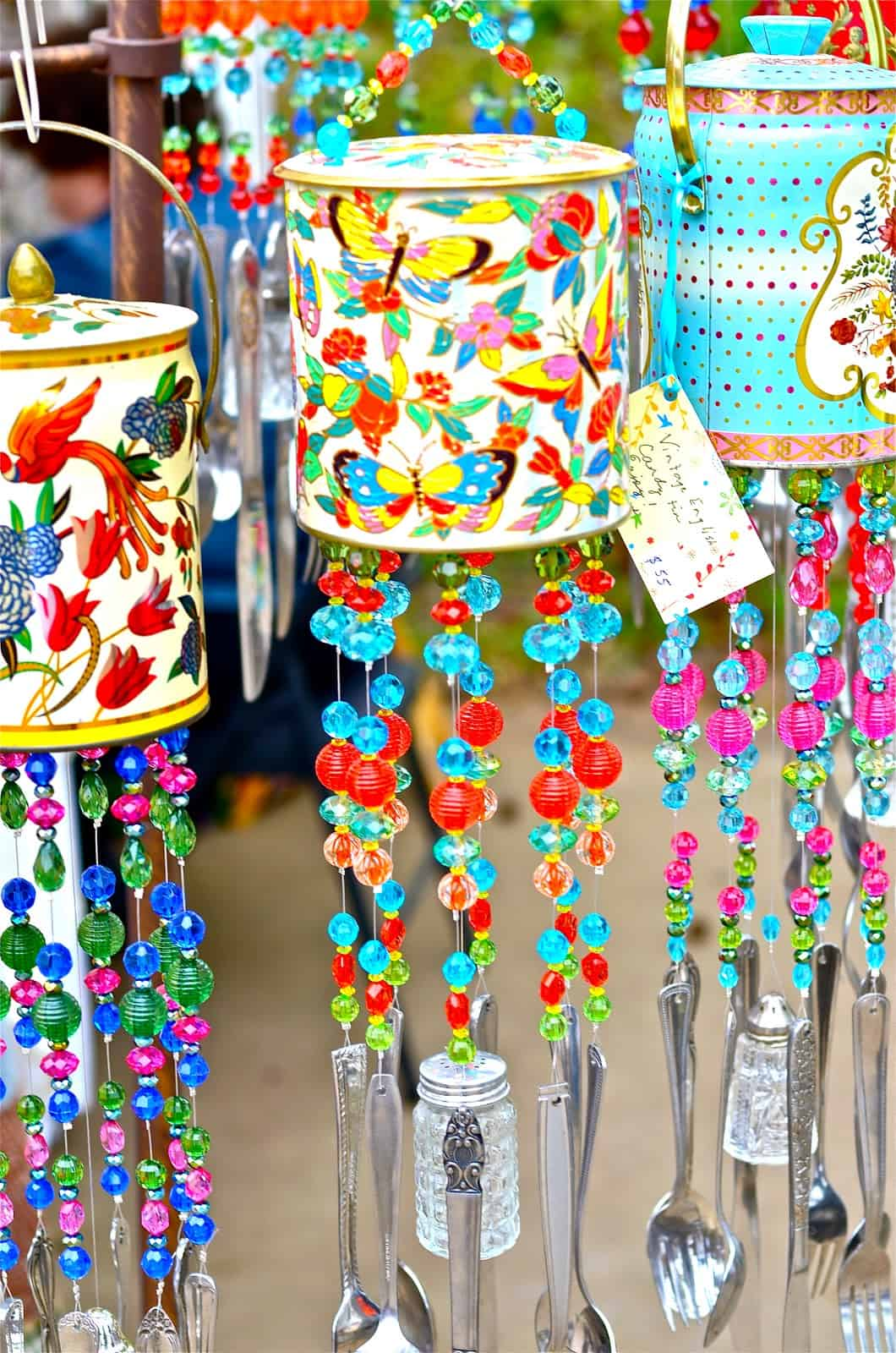 Colourful tin, cutlery, and bead wind chimes