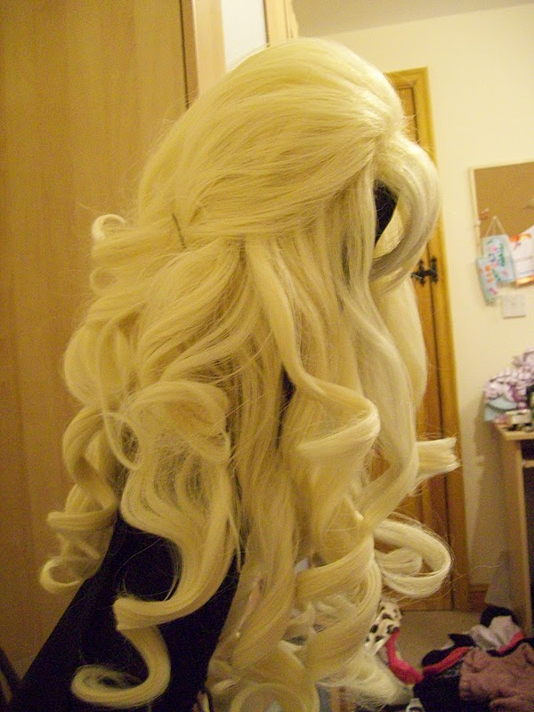 Proper brushing for curly synthetic wigs