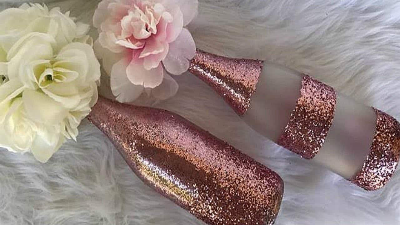 Rose gold glitter wine bottle centrepiece