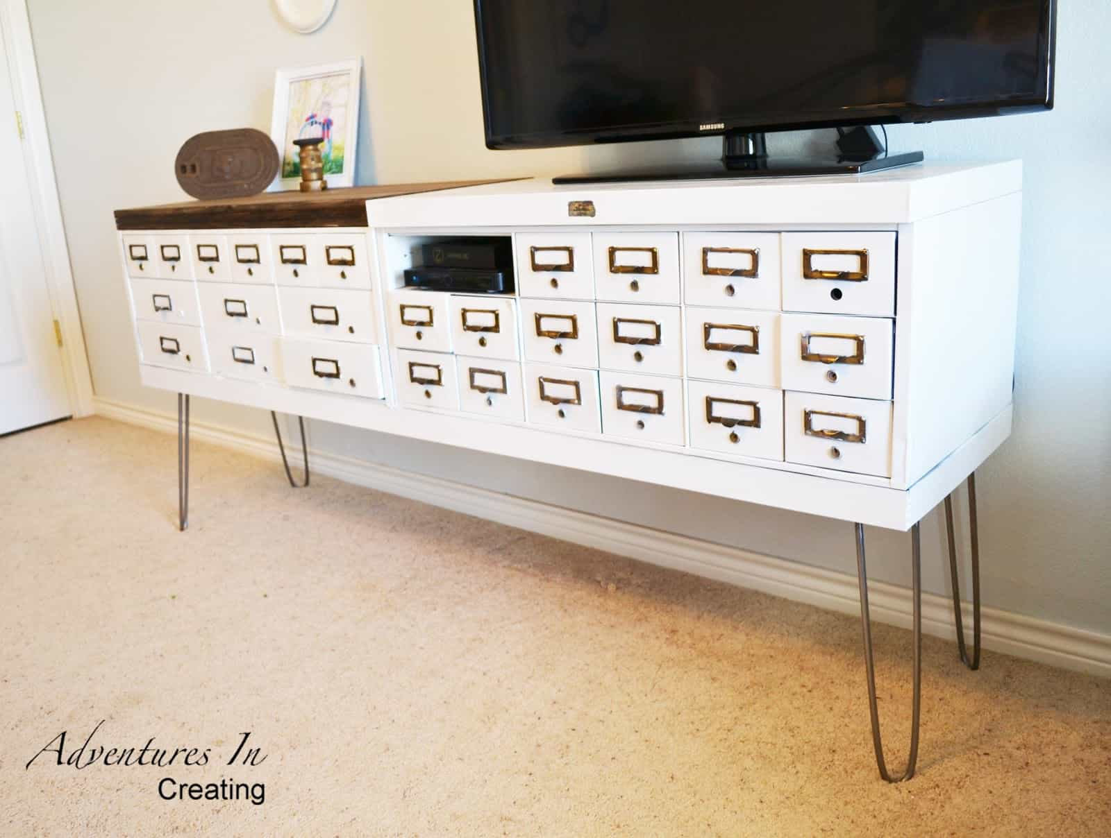 Vintage safe deposit box turned TV stand