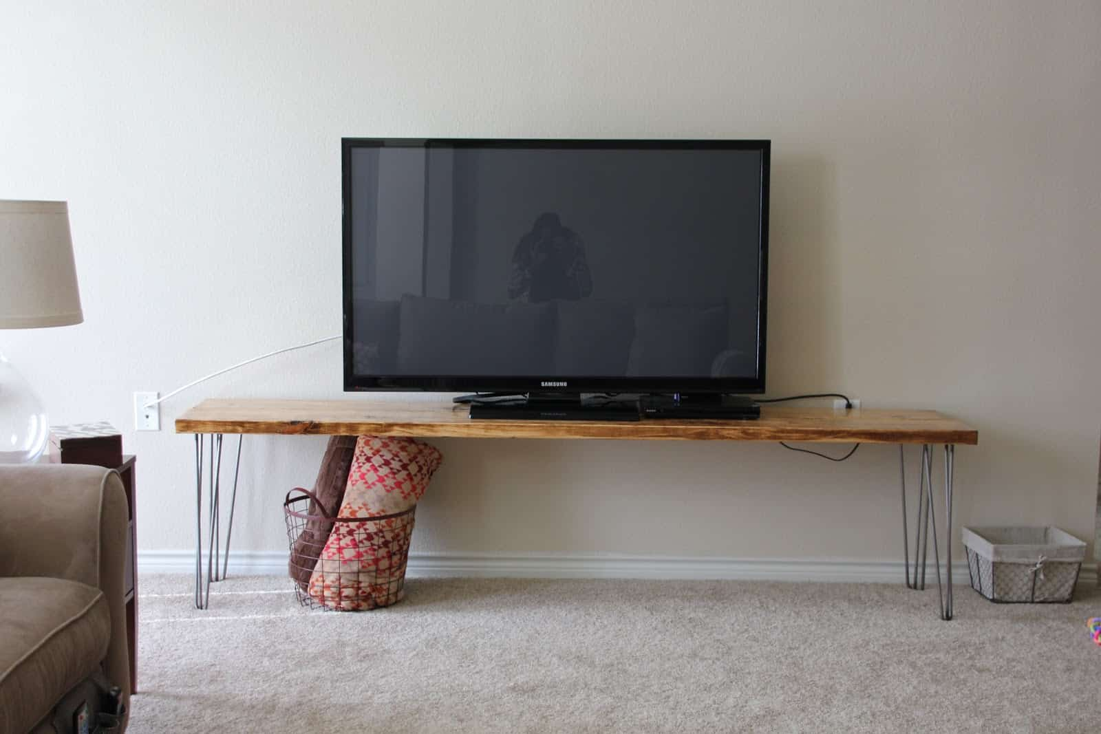 Wood and chair leg TV bench