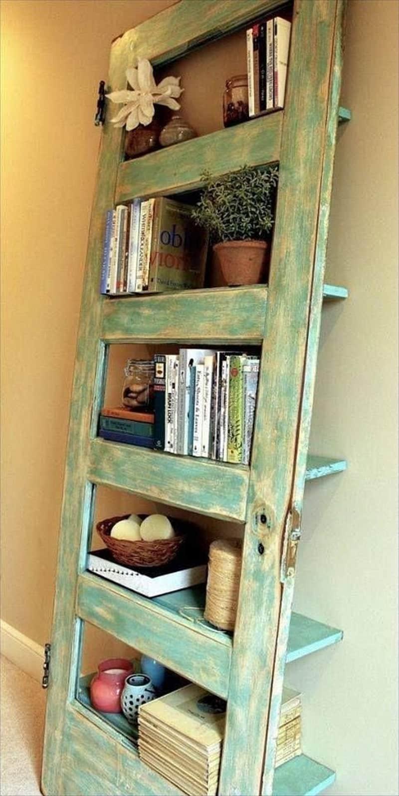Old door to leaning bookshelf