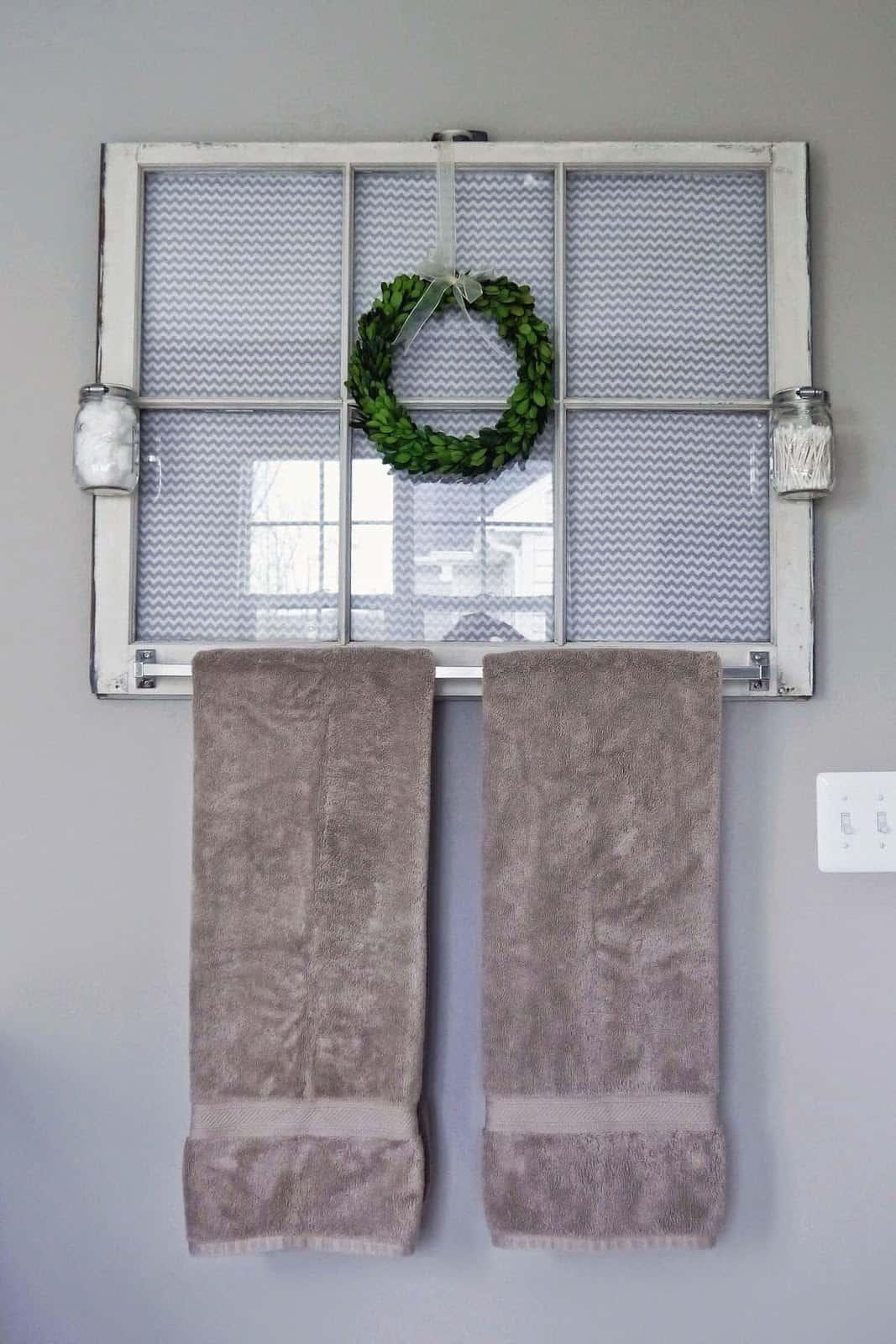 Old window turned towel rack