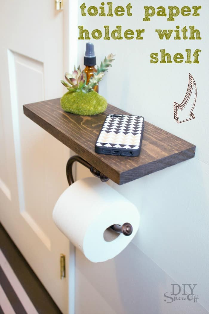 Toilet paper holder with a wall shelf