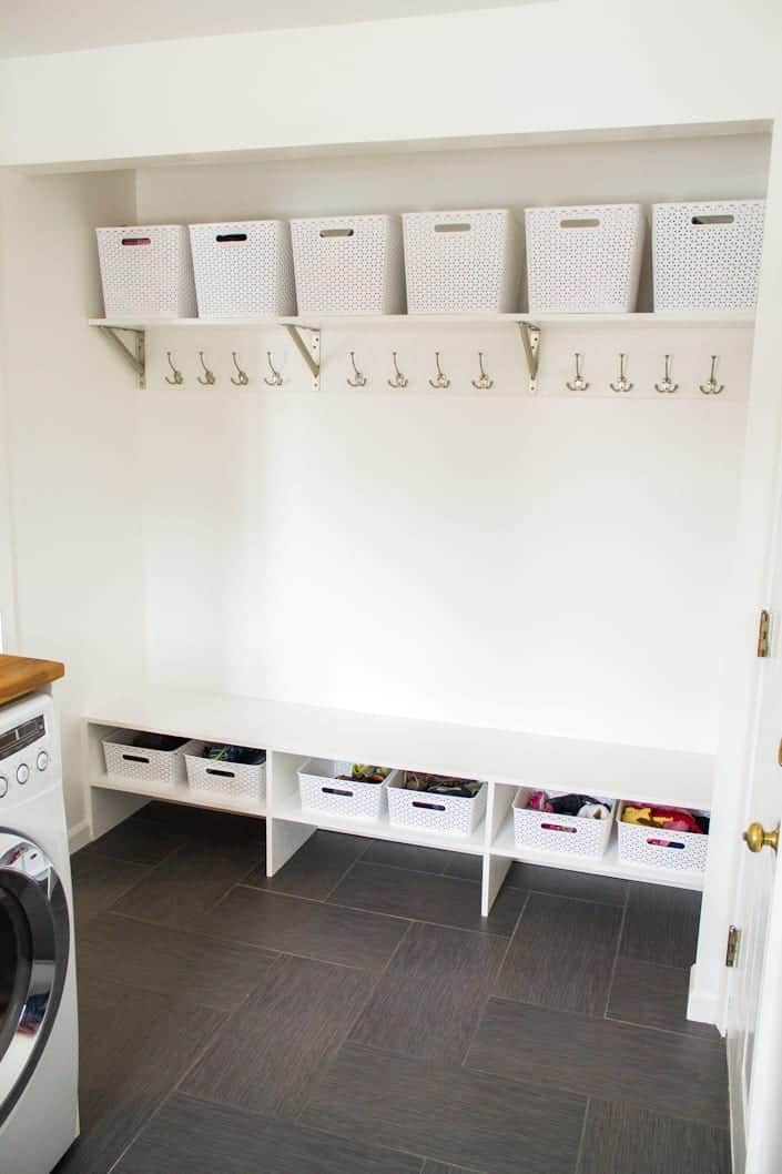 Add bins and hooks in the closet for better storage