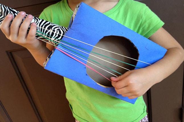 Cardboard and elastic guitar