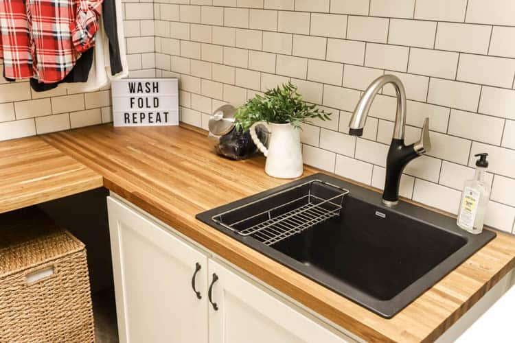 Reclaimed wood countertops for modern farmhouse laundry