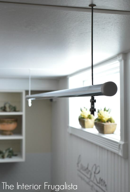 Suspended clothes drying rod