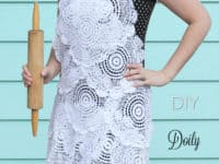 DIY lace doily apron 200x150 Delicately Crafty: 15 Pretty Things Made With Lace Doilies