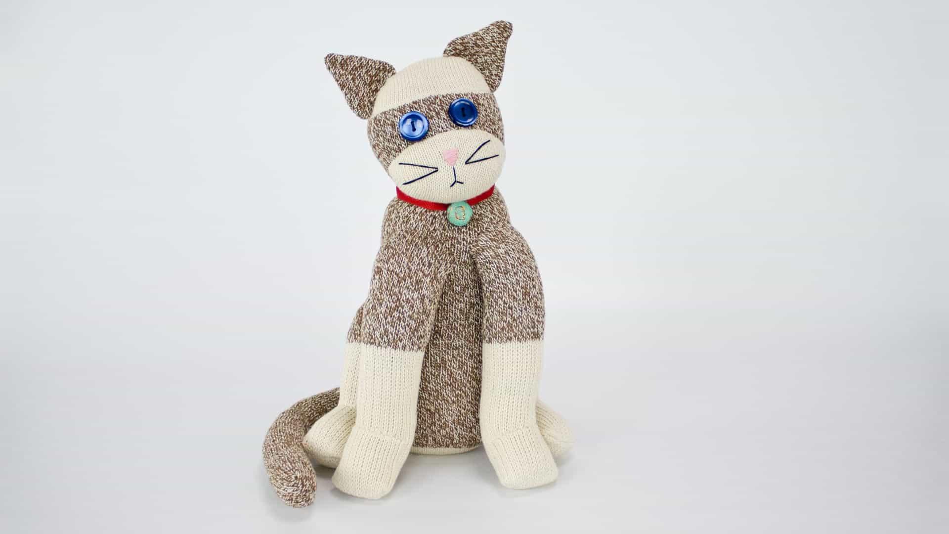Sock monkey style plush cat